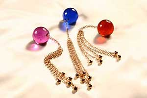 Insertable 34mm crystal orb with four Gold pendants