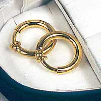 Non-piercing labia rings in gold. Pair.