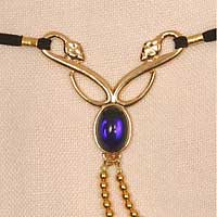 "Elastic Waistband, ""Serpent"" gold chain w/blue gem"
