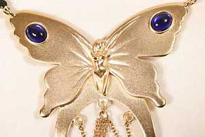 Women's butterfly waist band with saphire clitoral pendant-Gold.